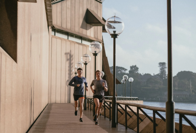 man and woman jogging by a river